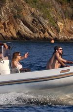 Kate Hudson In a red bikini sighted with Danny Fujikawa, Goldie Hawn and Kurt Russell on a speedboat in Mykonos