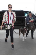 Kate Upton and her dog arrive at LAX