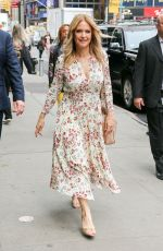 Kelly Preston Wearing a flowered dress as leaving Good Morning America in NYC