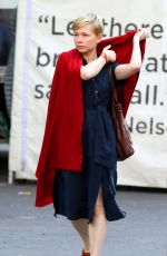 "Michelle Williams Wears a red throw while filming ""After The Wedding"" in Manhattan""s Union Square Garden"