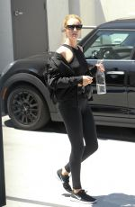 Rosie Huntington Whiteley Wears a sporty outfit as she leaves her gym after a workout