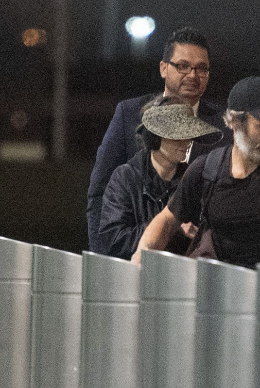 Winona Ryder Arriving at Laguardia Airport with a mystery man in New York