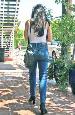 Aimee Garcia Shopping in a white tank top and denim jeans at Fred Segal In West Hollywood