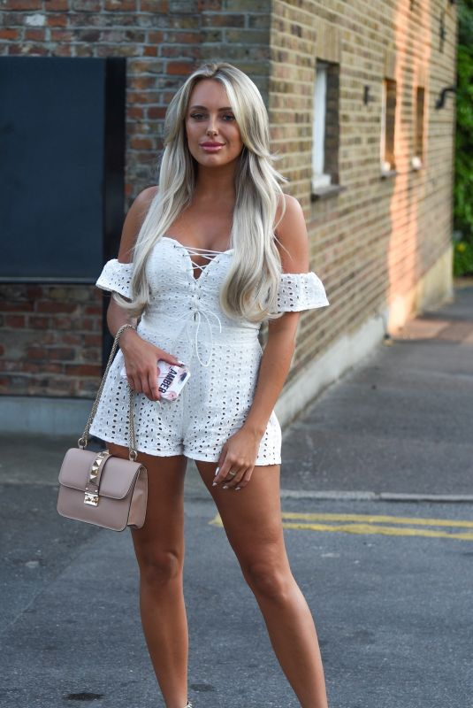 Amber Turner In a plunging lace-up playsuit out and about in Essex