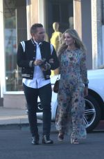 Annabelle Wallis Wears a pretty long floral dress to an event at Jonathan Simkhai in Los Angeles
