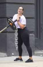 Ashley Graham Cuddles a pup as she and her shirtless husband Justin Ervin work out at The Dogpound gym in Manhattan