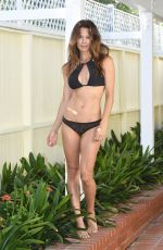 Brooke Burke In a black bikini on the beach in Malibu
