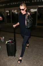 Charlize Theron At LAX after attending the International AIDS Conference