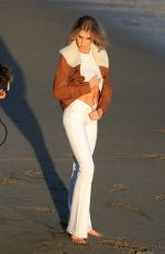 Charlotte McKinney Gets down and dirty for a photoshoot in Malibu