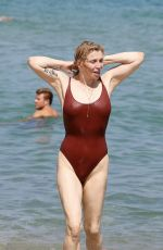Courtney Love Wearing a red swimsuit at the Club 55 in Saint-Tropez