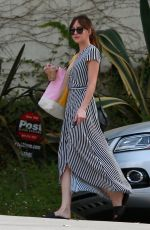 Dakota Johnson Wearing a striped summer dress out in Los Angeles