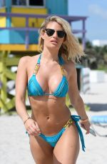 Danielle Armstrong Shows off her amazing beach body in an blue bikini on the beach in Miami