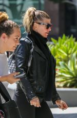 Fergie Walking into a building with a friend in Los Angeles