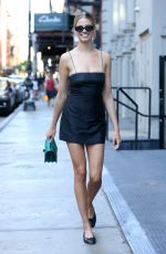 Hailey Clausen Seen wearing a little black dress leaving Lure Fishbar in Soho NYC