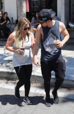 Hilary Duff Grabs an iced drink while shopping at the Farmer