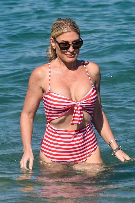 Hofit Golan In a red & white striped swimsuit at club 55 in St Tropez