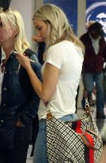 Jennifer Lawrence Waiting for luggage at LAX airport in Los Angeles