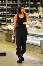 Kendall Jenner Wears old School cartoon socks as she stops by a grocery store for a late night slice of Pizza in Los Angeles
