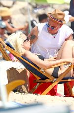 Lady Gaga In a black two piece bikini while frolicking in the surf in the Hamptons