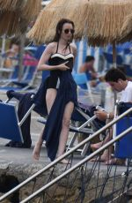 Lily Collins In a black one-piece bathing suit at the Isabella hotel in Ischia