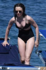 Lily Collins Wearing a black one piece bathing suit at the Hotel Regina Isabella in Ischia Porto
