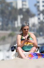 Lisa Armstrong at the beach in Malibu taking selfies and smoking cigarettes
