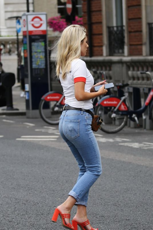 Mollie King Dashing for a cab in central London