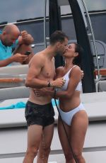 Nicole Scherzinger and Grigor Dimitrov frolicking in front of the famous Club 55 restaurant after lunch in Saint Tropez
