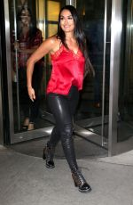 Nikki & Brie Bella In red while taking care of business together in New York City