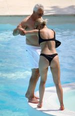 Rita Ora Having fun by the pool with her Boyfriend and Family