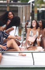Winnie Harlow and Cindy Bruna show off their curves in bikinis on a yacht in Miami