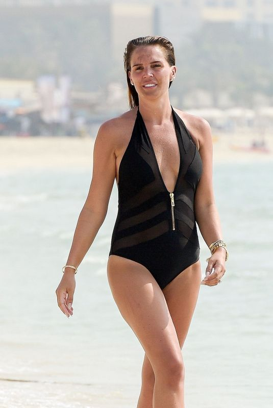 Danielle Lloyd In Halter neck Black swimsuit on the beach in Dubai