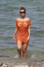 Emily Sears In an off-the-shoulder crochet dress and bikini on the beach in Miami