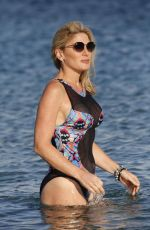Hofit Golan In one piece swimming costume in the sea on Mykonos Island