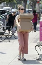 Judy Greer Carries a stack of packages while leaving the post office in Los Angeles