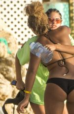 Kim Turnbull At a beach day with a friend in Barbados