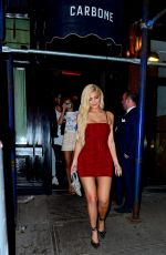 Kylie Jenner In Red As She Leaves A Dinner Party At Carbone In New York