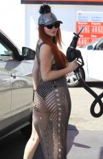 Phoebe Price Fills up her SUV at a gas station in Beverly Hills