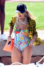 Rita Ora In a fetching colourful swimsuit while enjoying a day on holiday in Porto Cervo
