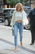 Rosie Huntington-Whiteley Wearing a revealing white top and jeans in New York