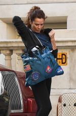 Anna Friel Struggling with her large luggage bags as she steps out make up free in London