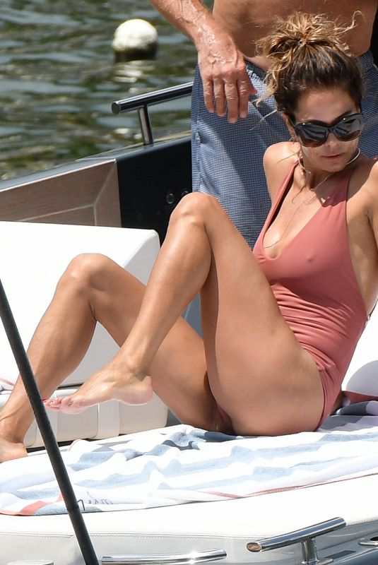 Brooke Burke Celebrates her birthday in a pink swimsuit with a mystery man in Miami