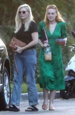 Dakota Fanning & Kirsten Dunst Heading to a small house party together with snacks and drinks in hand in Los Angeles