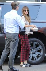 Dakota Johnson Hugging man after lunch meeting and gives thumbs up in Beverly Hills