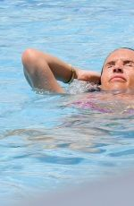 Danielle Lloyd Eats pizza as she relaxes by pool in Dubai