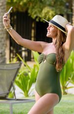 Danielle Lloyd Relaxes and takes selfies in a dark green swimsuit in Dubai