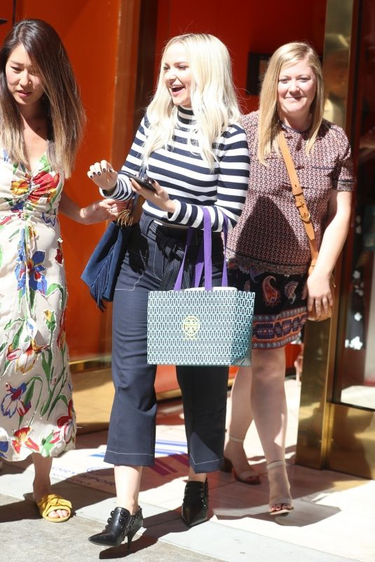 Dove Cameron Attends the Tory Burch party and greets fans as she leaves in Beverly Hills