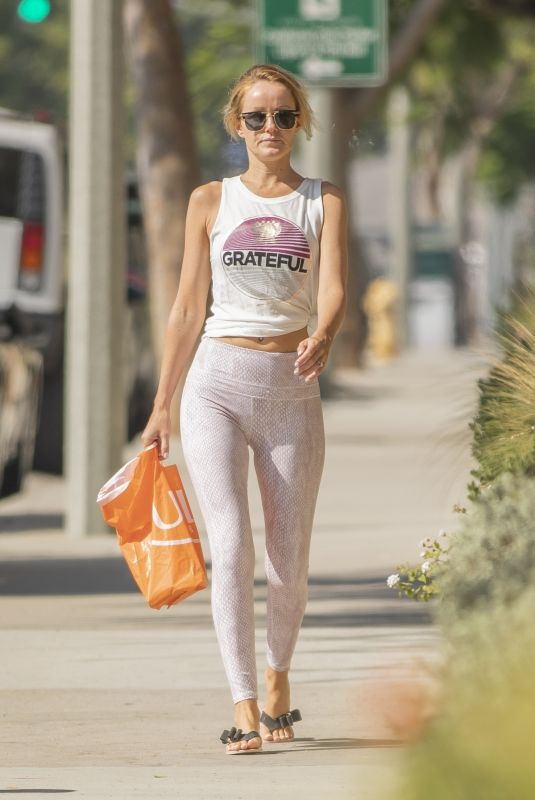 Hayley Roberts Baring her midriff while taking an early morning walk in Calabasas
