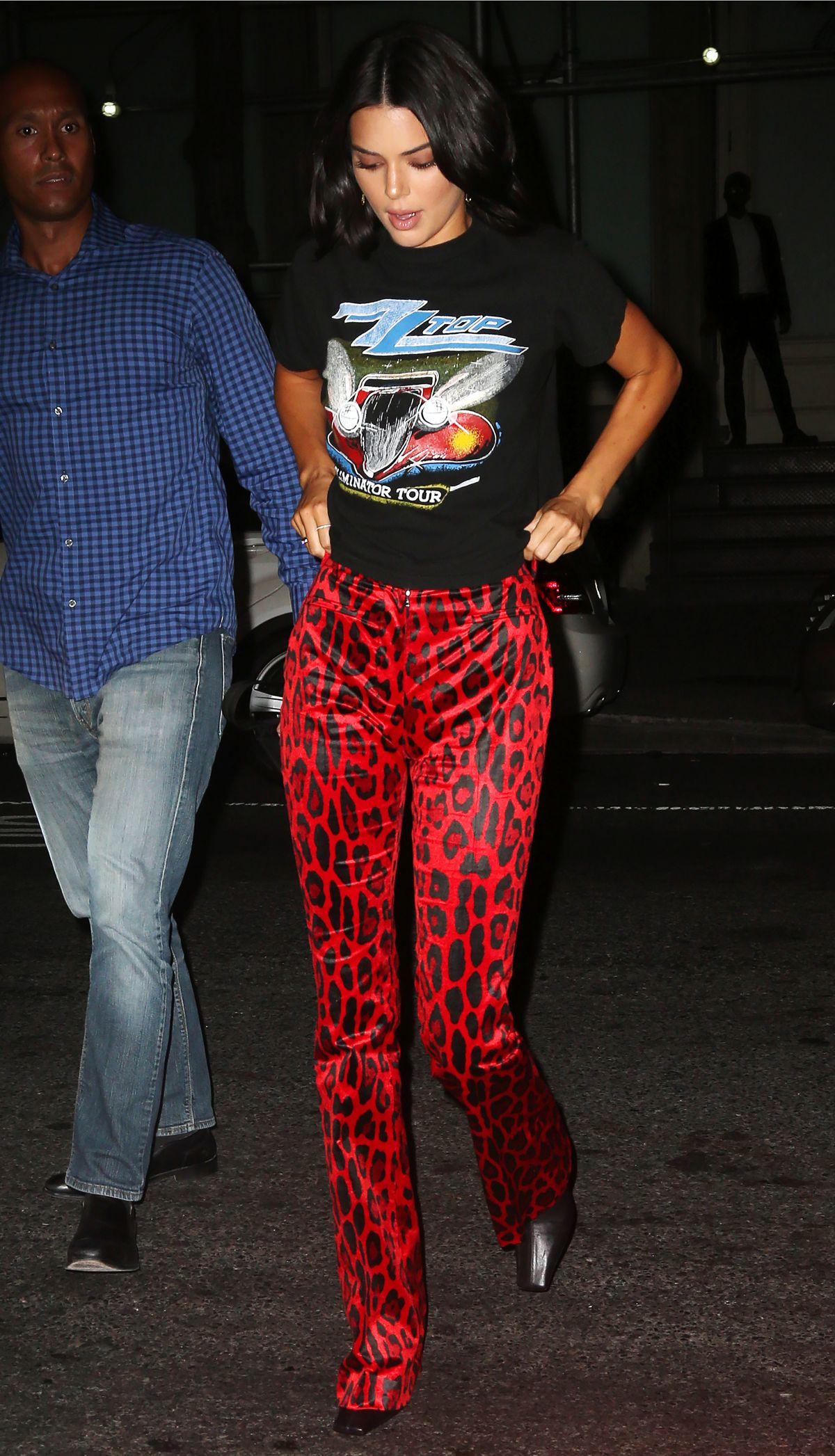 8c7c71ff537a Kendall Jenner Wears a graphic tee and red animal print pants as she heads  to her