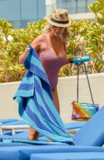 Laura Anderson Ielaxes on a sunbed on the beach in Dubai